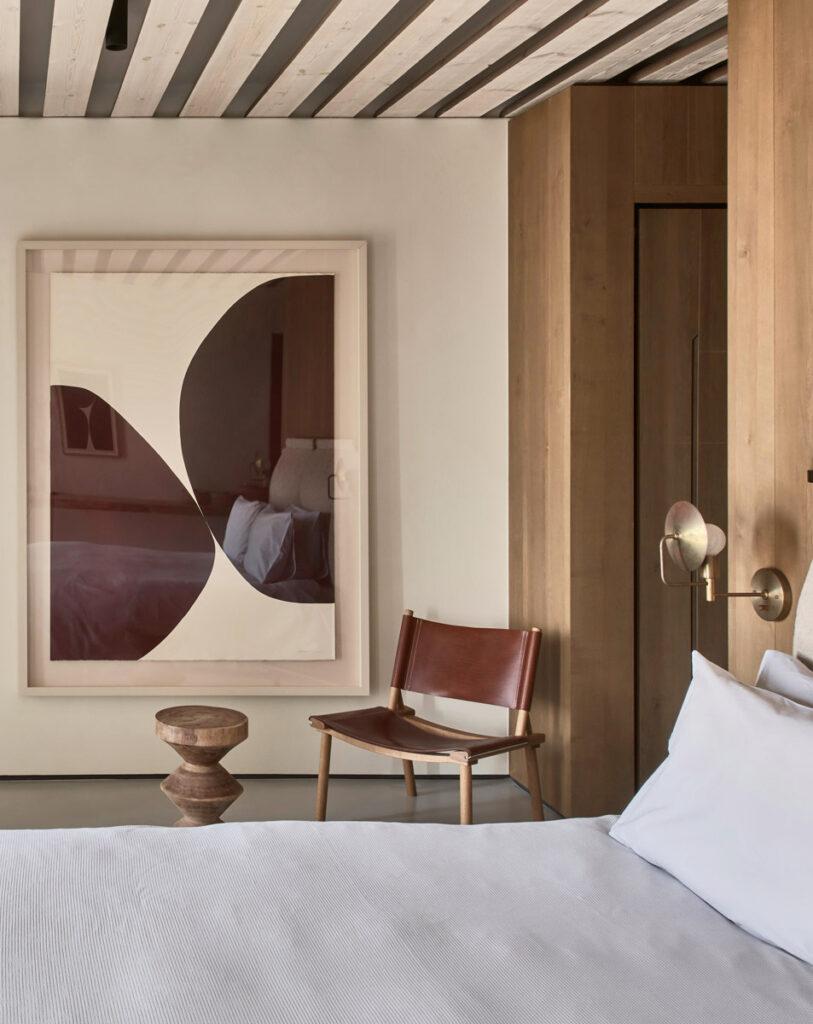 A bedroom at Villa Mandra with modern art: A Summer Home In Mykonos, Greece.